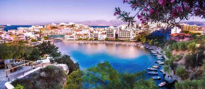 The lake Voulismeni in Agios Nikolaos,  a picturesque town in the eastern part of the island Crete, Greece